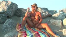 Smoking nude on the beach 8